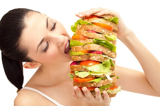 Eating when full: A battle between two brain signals